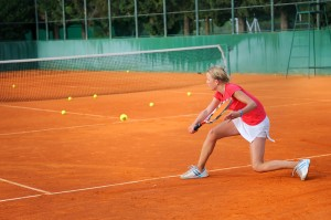 bigstock-Girl-playing-tennis-outdoor-on-14817080-300x199